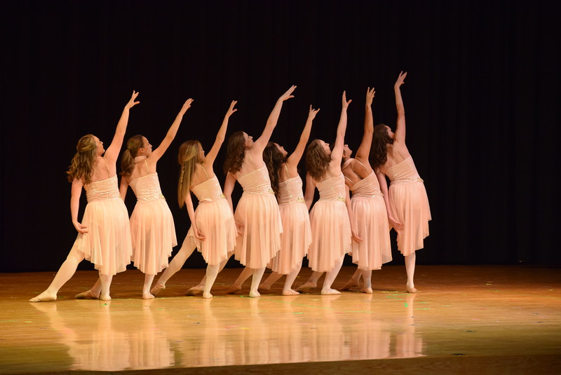"""Emory Lesh, Emory Underwood, Sonjia Hadley, Sydney Wright, Dillyn Morton, Katie Masters, Tabby Rangel and Abigail Smith dance to """"What Huts the Most"""" at Melissa's School of Dance and Gymnastics' """"Remember When"""" spring recital Wednesday, June 14, 2017."""