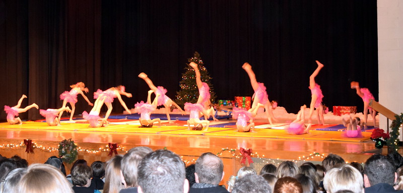 """Gymnasts Aja Richie, Aeris Evanson, Taylor Tonche, Sophia Rios, Ava Reeves, Hailey Foos, Lauren Lorenzo, Ciana Lousberg, Ashley Bornhoft, Grace Peterson, Elizabeth Cordova, Cheyanne Buchanan, Abby Paceco, Connie Gassaway, Sydney Simmons and Serenety Dick show off their skills to the tune """"O' Come All Ye Faithful"""" at Melissa's School of Dance and Gymnastics' holiday recital, """"T'was the Night Before Recital...,"""" Saturday, Dec. 17, 2016."""
