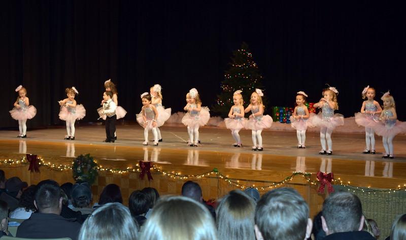 "Monic Weis, Mathew Baird, Victoria Hulbert, Laurel Murphy, Callie Schoenberg, Gracie Abrahamson, Brinkley Hecht, Bristol Cook, Adley Larralde, Ashtyn Fuller, Brynn McBride, Syrie Richie, Jayla Samen, Makenna Eastin, Lilly Johnson and Mya DeMaria dance to ""Jingle Bells"" at Melissa's School of Dance and Gymnastics' holiday recital, ""T'was the Night Before Recital...,"" Saturday, Dec. 17, 2016."