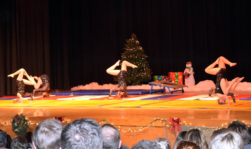 """Gymnasts Madison Amen, Kashley Sheets, Lexi Shaefer, Dillyn Morton, Leah Fuller and Malerie Crouch show off their skills to the tune of """"Christmas Eve"""" at Melissa's School of Dance and Gymnastics' holiday recital, """"T'was the Night Before Recital...,"""" Saturday, Dec. 17, 2016."""