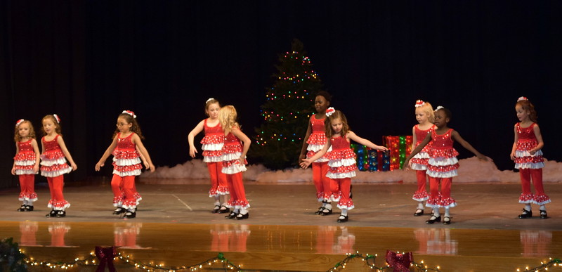 "Veronica Renteria, Maddie Nolan, Leila Warden, Shaylee Henry, Morgan Frankenfeld, Fidha Mackintosh, Zoey Luttrell, Ella Sonnenberg, Zoey Annis, Christina Mackintosh, Laurel Julius and Chloee Kloberdanz dance to ""Up on the Housetop"" at Melissa's School of Dance and Gymnastics' holiday recital, ""T'was the Night Before Recital...,"" Saturday, Dec. 17, 2016."