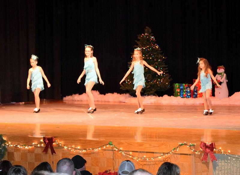 "Kenah Meraz, Kailynne Swingle, Ashley Bornhoft and Emoree Lousberg dance to ""Winter Wonderland"" at Melissa's School of Dance and Gymnastics' holiday recital, ""T'was the Night Before Recital...,"" Saturday, Dec. 17, 2016."