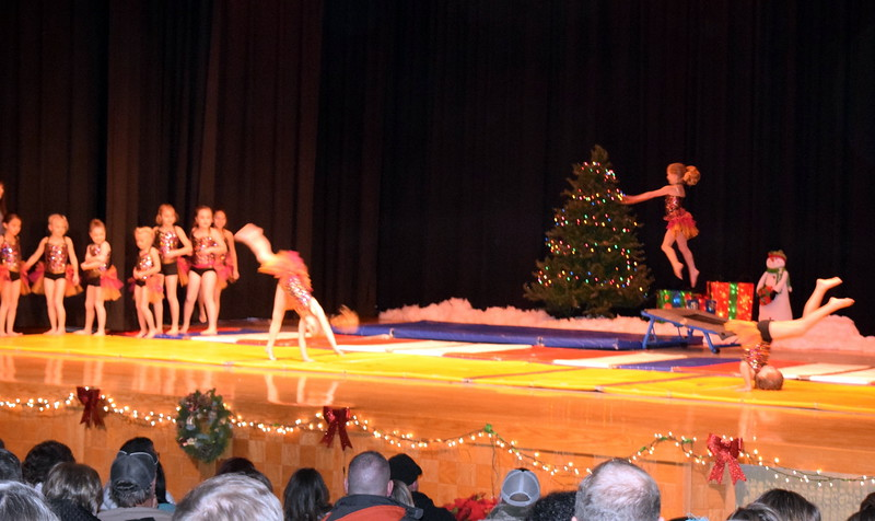 "Gymnasts Hannah Kugler, Faith Woodside, Elizabeth Waller, Kenzi Rubottom, Annabelle Hulbert, Shaylee Henry, Chloe Hutcheson, Bryn Cook, Makayla Stratton, Lindsey Richie, Charlotte Horton, Alexis Breidenbach, Karsyn Tonche, Aubrey Luttrell and Tatum Bown show off their skills to the song ""Merry Christmas"" at Melissa's School of Dance and Gymnastics' holiday recital, ""T'was the Night Before Recital...,"" Saturday, Dec. 17, 2016."
