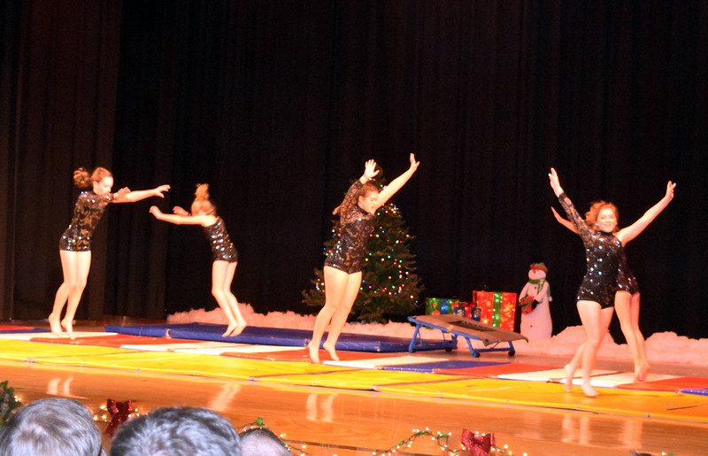 "Gymnasts Madison Amen, Kashley Sheets, Lexi Shaefer, Dillyn Morton, Leah Fuller and Malerie Crouch show off their skills to the tune of ""Christmas Eve"" at Melissa's School of Dance and Gymnastics' holiday recital, ""T'was the Night Before Recital...,"" Saturday, Dec. 17, 2016."