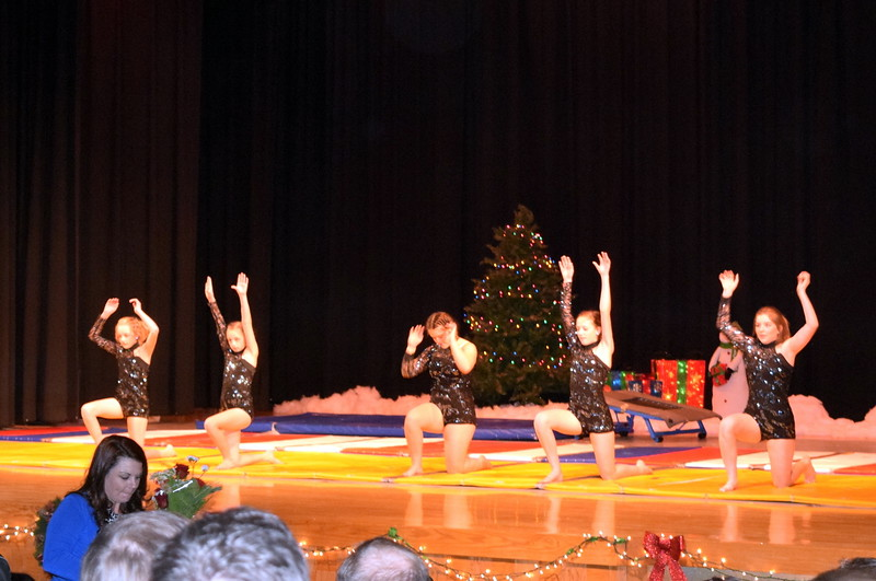 "Gymnasts Madison Amen, Kashley Sheets, Lexi Shaefer, Dillyn Morton, Leah Fuller and Malerie Crouch take a bow following their performance during Melissa's School of Dance and Gymnastics' holiday recital, ""T'was the Night Before Recital...,"" Saturday, Dec. 17, 2016."