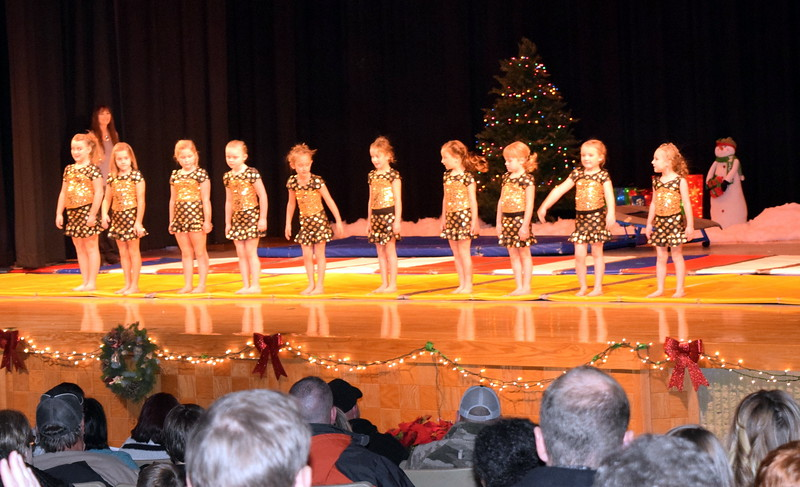 "Gymnasts Faithe Spicer, Bryar Lee, Madalynn Rinaldo, Aly Johnson, Noelle Murphy, Lucy Ensminger, Jorjia Stroyek, Chloee Kloberdanz, Madison Nolan and Zoey Luttrell take a bow at the end of their performance during Melissa's School of Dance and Gymnastics' holiday recital, ""T'was the Night Before Recital...,"" Saturday, Dec. 17, 2016."