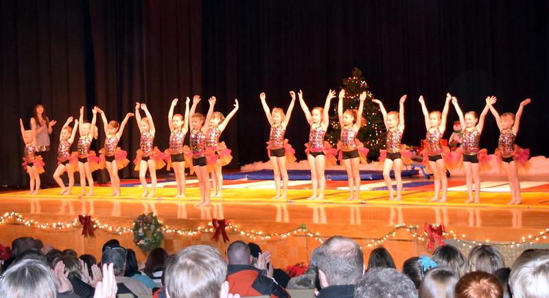 "Gymnasts Hannah Kugler, Faith Woodside, Elizabeth Waller, Kenzi Rubottom, Annabelle Hulbert, Shaylee Henry, Chloe Hutcheson, Bryn Cook, Makayla Stratton, Lindsey Richie, Charlotte Horton, Alexis Breidenbach, Karsyn Tonche, Aubrey Luttrell and Tatum Bown take a bow following their performance during Melissa's School of Dance and Gymnastics' holiday recital, ""T'was the Night Before Recital...,"" Saturday, Dec. 17, 2016."