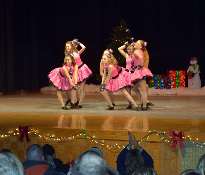 "Abbey Zink, Charlie Frankenfeld, Emi Reeves, Cristen Kircher, Molly Mitchell, Madison Amen and Marissa Evanson dance to ""Boogie Woogie Choo Choo Train"" at Melissa's School of Dance and Gymnastics' holiday recital, ""T'was the Night Before Recital...,"" Saturday, Dec. 17, 2016."