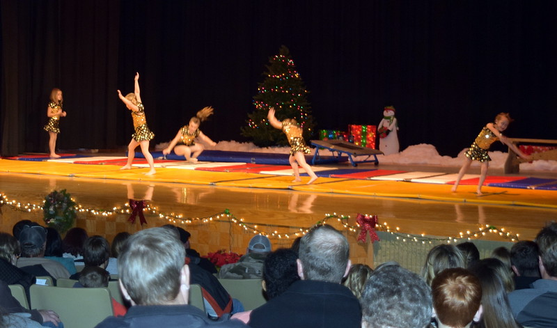 "Gymnasts Faithe Spicer, Bryar Lee, Madalynn Rinaldo, Aly Johnson, Noelle Murphy, Lucy Ensminger, Jorjia Stroyek, Chloee Kloberdanz, Madison Nolan and Zoey Luttrell show off their skills to the tune of ""Polar Express"" at Melissa's School of Dance and Gymnastics' holiday recital, ""T'was the Night Before Recital...,"" Saturday, Dec. 17, 2016."