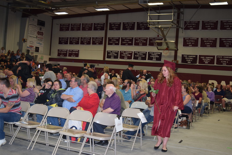 Merino High School graduates present flowers to their family and friends during commencement Sunday, May 21, 2017.