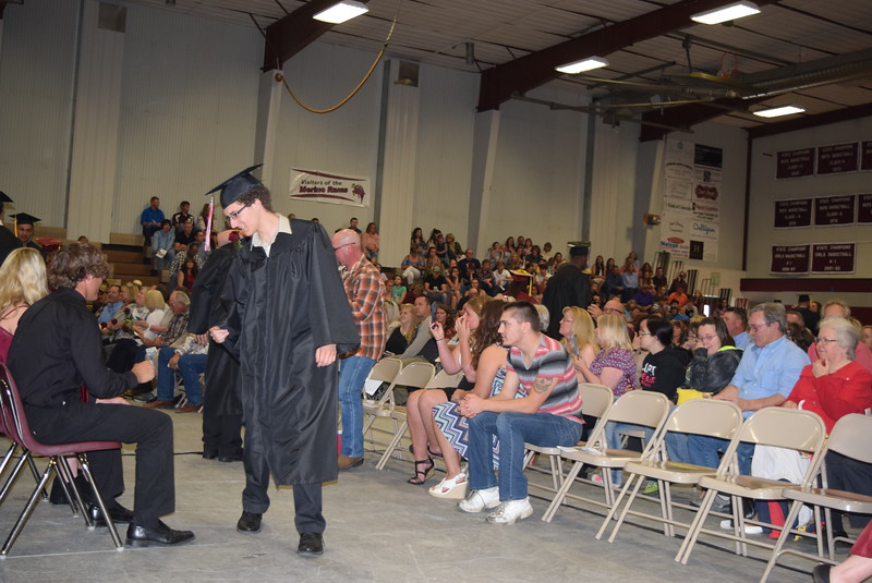 Merino High School graduates present flowers to their family and friends and get congratulations during commencement Sunday, May 21, 2017.