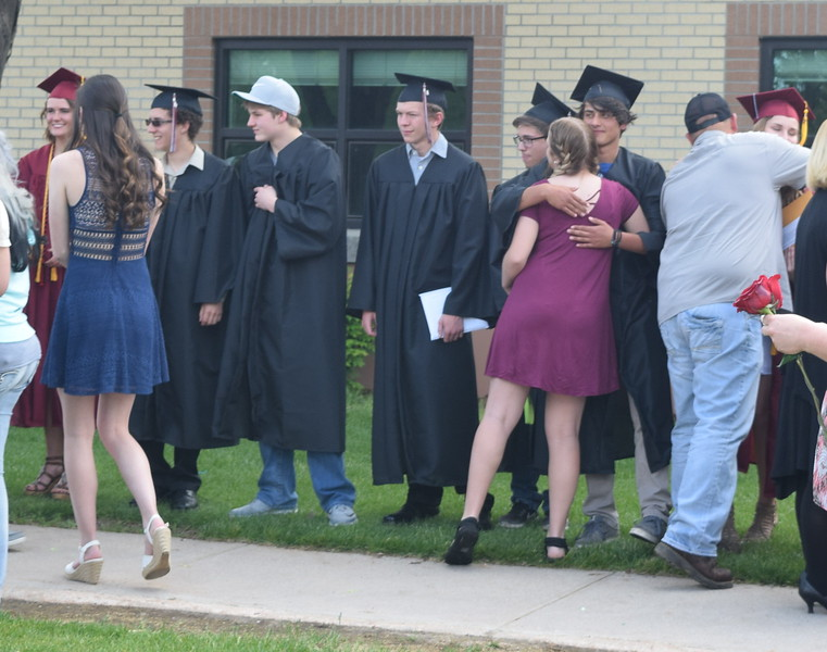 Merino High School graduates are congratulated following commencement exercises Sunday, May 21, 2017.