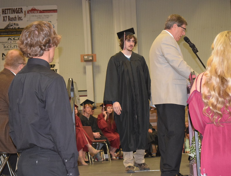 Valedictorian Jacob Matthews is recognized by career counselor Bryan Dermer during the scholarship portion of Merino High School's commencement Sunday, May 21, 2017. Matthews was also recognized for having graduated from Northeastern Junior College with an associate's degree on May 12.