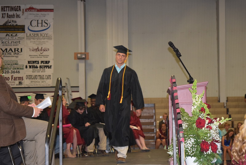 Merino High School graduate Colin Mertens makes his way to the podium to give closing remarks at Merino High School's commencement exercises Sunday, May 21, 2017.