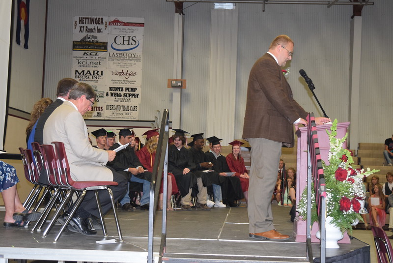 Merino High School graduates listen to Principal Lonnie Brungardt speak at commencement Sunday, May 21, 2017.