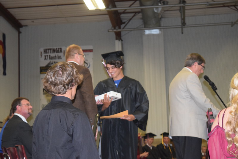 Merino High School Principal Lonnie Brungardt presents a tablet donated by an anonymous donor to graduate Lake Vanmeter at commencement exercises Sunday, May 21, 2017.