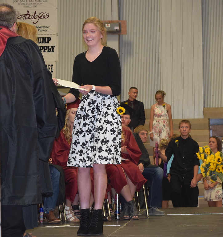 . Eighth grade class president Taysa Conger receives her diploma during the continuation ceremony Sunday, May 20, 2018.