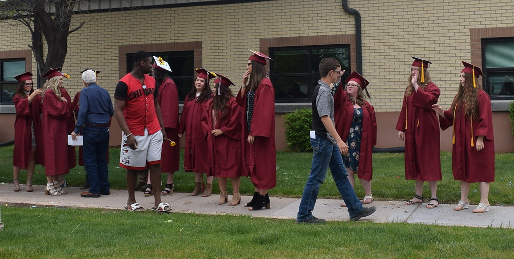 . Merino High School graduates stand in line to be congratulated following the commencement ceremony Sunday, May 20, 2018.