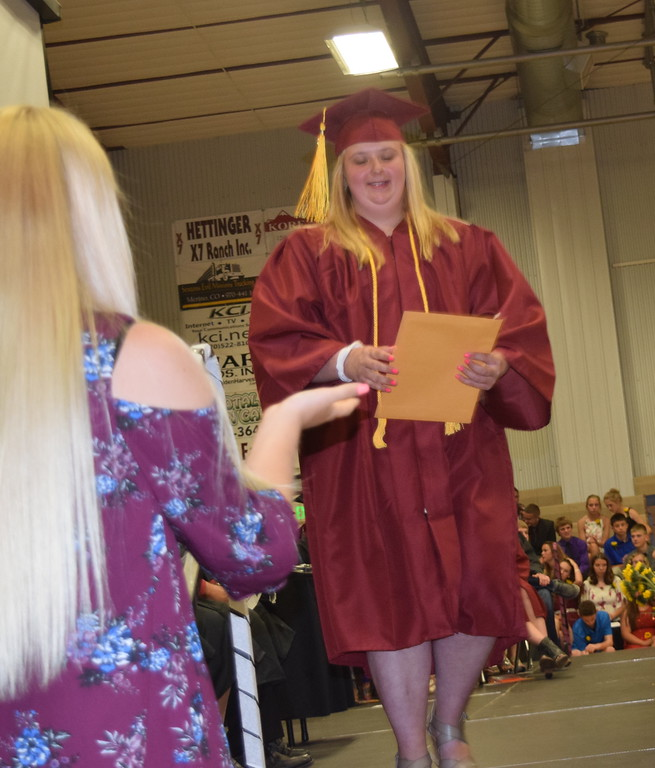 . Scholarship recipient Sarah Wiebers exits the stage after being recognized during the commencement ceremony Sunday, May 20, 2018.