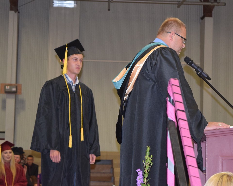 . Merino High School principal Lonnie Brungardt introduces valedictorian Zach Karg during the commencement ceremony Sunday, May 20, 2018.