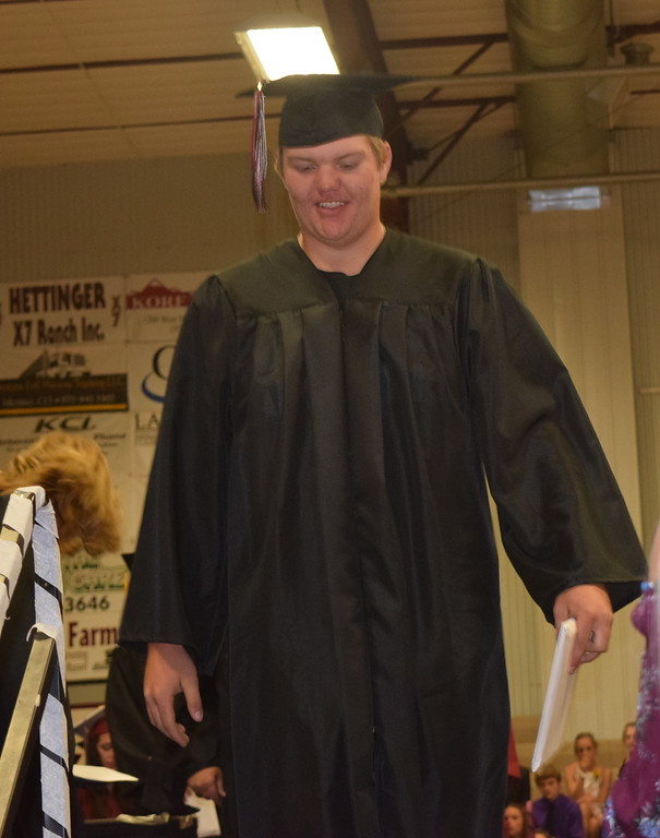 . Merino High School graduate Chase Legg exits the stage after receiving his diploma during the commencement ceremony Sunday, May 20, 2018.