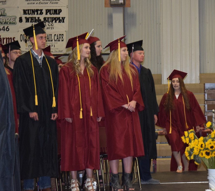 . Merino High School graduates make their way on stage at the start of the commencement ceremony Sunday, May 20, 2018.