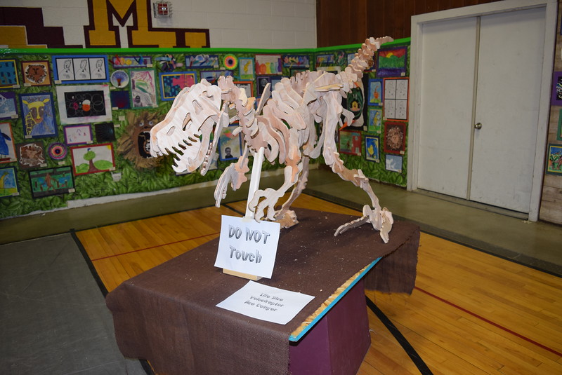 A life size Velociraptor, created by Ace Conger, was among the artwork on display at Merino High School and Elementary's Walking Dinner Thursday, April 28, 2016.