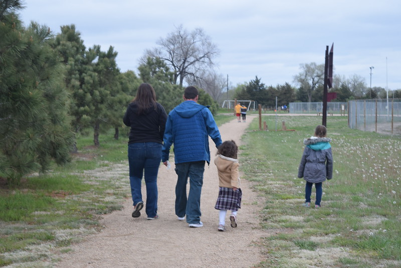 Families make their way down the interactive fitness trail to the next food station during Merino High School and Elementary's Walking Dinner Thursday, April 28, 2016.