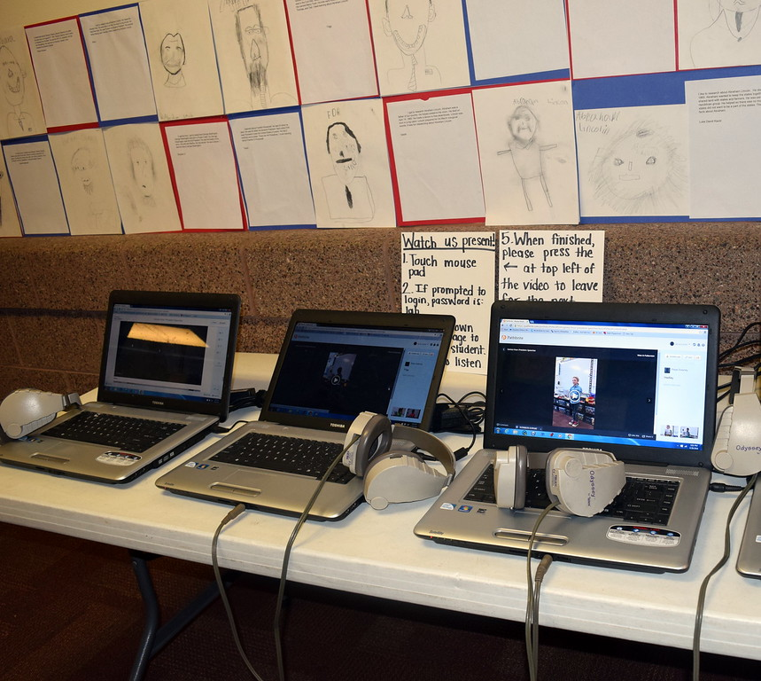 Laptops showing videos of students giving reports on different United States presidents were part of the projects on display at Merino High School and Elementary's Walking Dinner Thursday, April 28, 2016.
