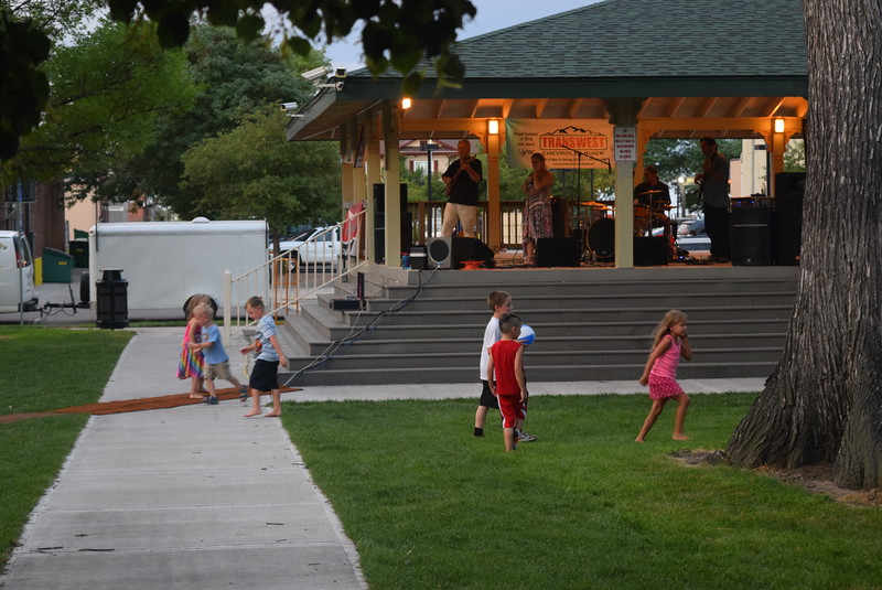Children have fun running around as they listen to the music of Mojomama at the Transwest Concerts on the Green..July Jamz concert Friday, July 22, 2016.