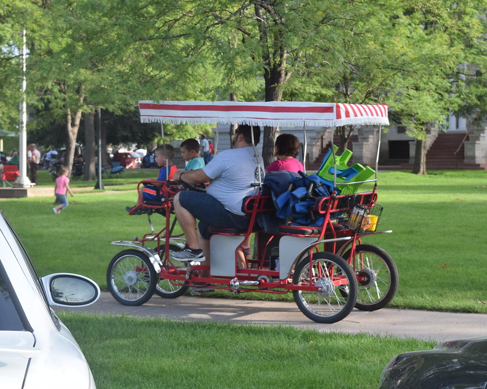 A family makes their way to the July Jamz concert on their bicycle Friday, July 22, 2016.