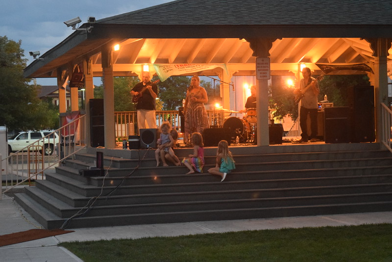 Children enjoy the music of Mojomama up close at the Transwest Concerts on the Green...July Jamz concert Friday, July 22, 2016.