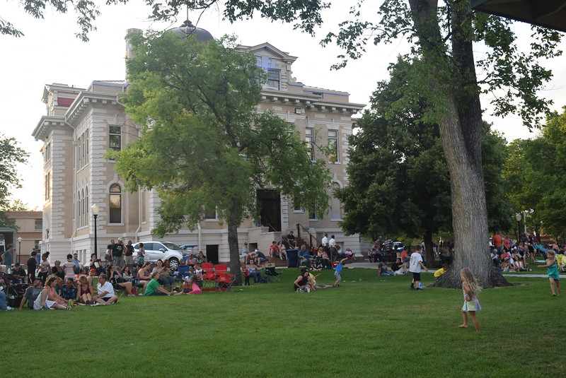 A crowd gathered to listen to the music of Mojomama at the Transwest Concerts on the Green...July Jamz concert Friday, July 22, 2016, at the Logan County Courthouse.