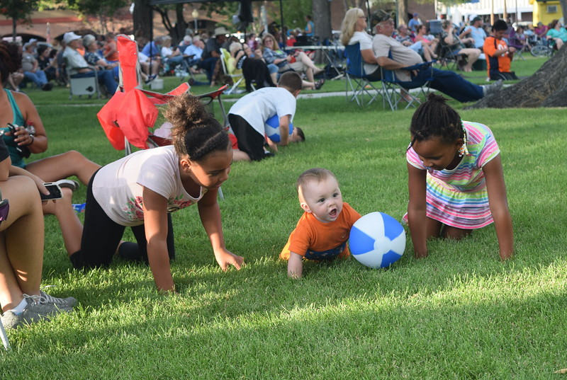 Beach balls given out by Colorado Christian University provided fun for children at the July Jamz concert Friday, July 22, 2016.