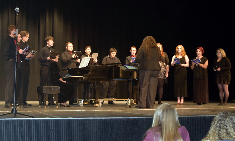 """Northeastern Junior College's musical groups entertained at the Winter Ensemble Concert Saturday, Dec. 10, 2016, performing a variety of Christmas songs, as well as a few other tunes. Here the contemporary choir performs """"America the Beautiful,"""" under the direction of Celeste Delgado-Pelton and accompanied by Mary Smith."""