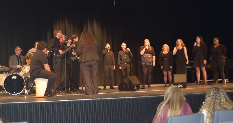 "The NJC contemporary choir performs ""Stitches,"" under the direction of Celeste Delgado-Pelton, during NJC's Winter Ensemble Concert, Saturday, Dec. 10, 2016. Accompanying them are Brandon Bade, guitar; Seth Hill, bass; Darian Wilkening, cajón; and Lee Lippstrew, percussion and cajón."