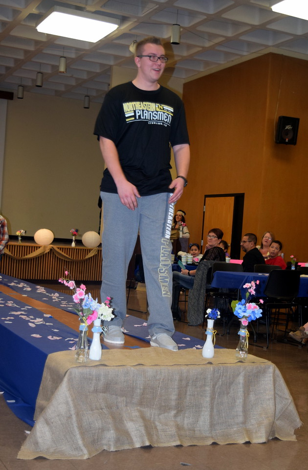 Gavin Fitzgerald models a t-shirt and sweatpants from the NJC Cosmetology Fashion Show Fundraiser Saturday, Feb. 25,  2017.NJC Bookstore.