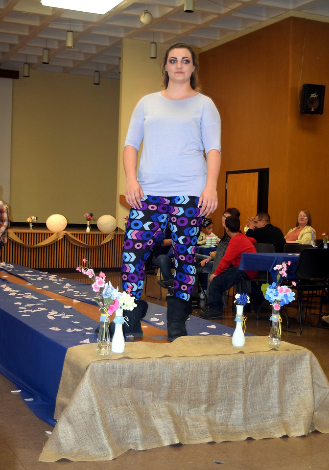 A Northeastern Junior College student models leggings and a top from LuLaRoe at the NJC Cosmetology Fashion Show Fundraiser Saturday, Feb. 25,  2017.