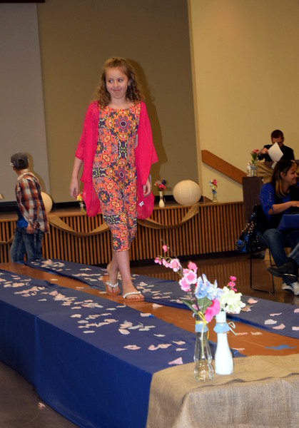 A young model walks the stage in a dress from LuLaRoe at the NJC Cosmetology Fashion Show Fundraiser Saturday, Feb. 25, 2017.