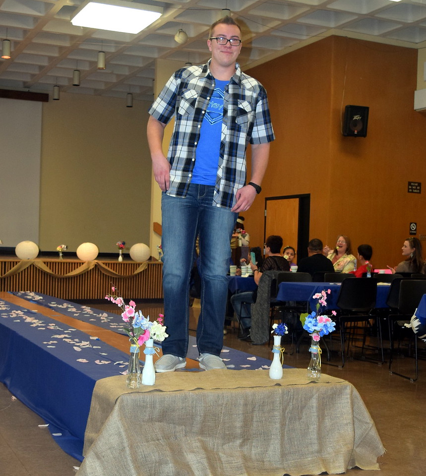 Gavin Fitzgerald models jeans, a t-shirt and overshirt from the Buckle at the NJC Cosmetology Fashion Show Fundraiser Saturday, Feb. 25,  2017.