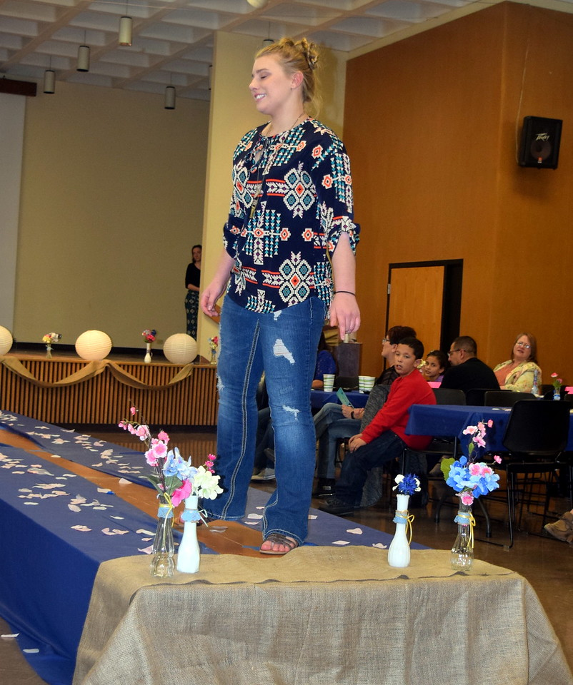 A Northeastern Junior College student models jeans and a top from Clothes Line at the NJC Cosmetology Fashion Show Fundraiser Saturday, Feb. 25,  2017.