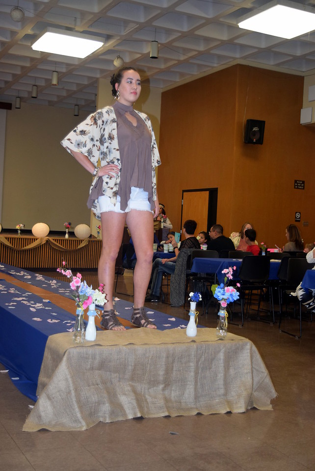 Katie Saunders models shorts an a top from Buckle at NJC Costmetology's Fashion Show Fundraiser Saturday, Feb. 25, 2017.