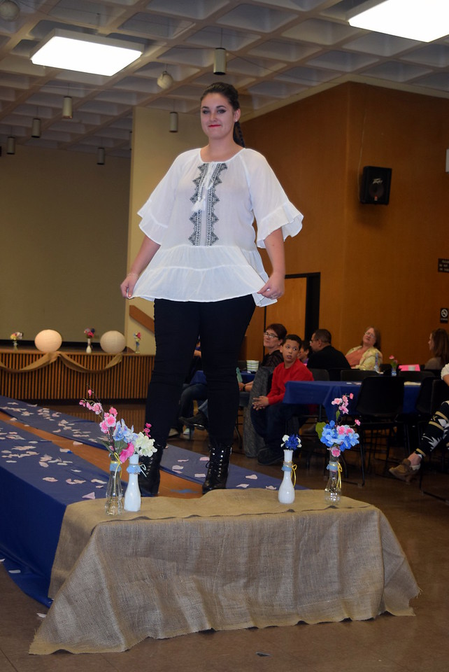 Jordan Will models a shirt and pants from Barb's Gifts at the NJC Cosmetology Fashion Show Fundraiser Saturday, Feb. 25,  2017.