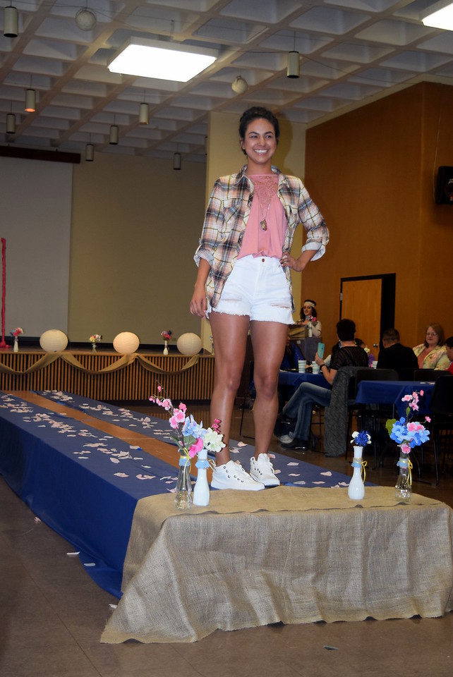 Ava Ortega models shorts, a t-shirt and an overshirt from the Buckle at the NJC Cosmetology Fashion Show Fundraiser Saturday, Feb. 25,  2017.