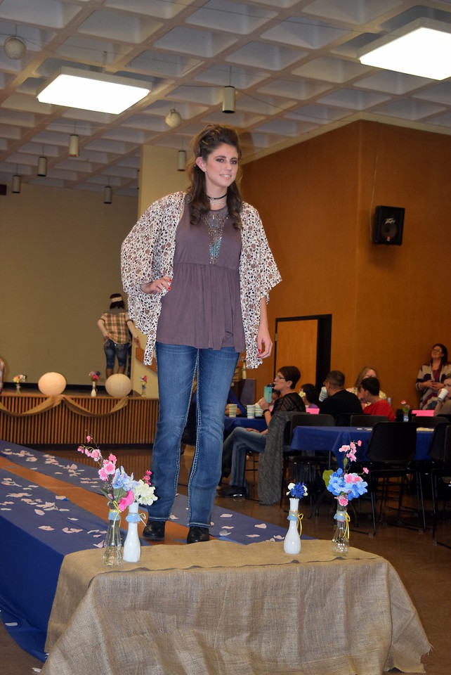 A Northeastern Junior College student models jeans, a top and shawl from the Buckle at the NJC Cosmetology Fashion Show Fundraiser Saturday, Feb. 25,  2017.