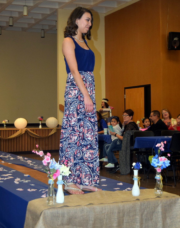 A Northeastern Junior College models a dress from Bealls at the NJC Cosmetology Fashion Show Fundraiser Saturday, Feb. 25,  2017.