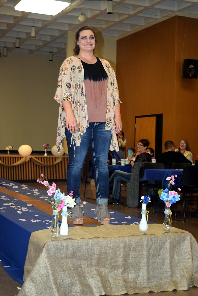 A Northeastern Junior College student models jeans and a top from the Buckle at the NJC Cosmetology Fashion Show Fundraiser Saturday, Feb. 25,  2017.