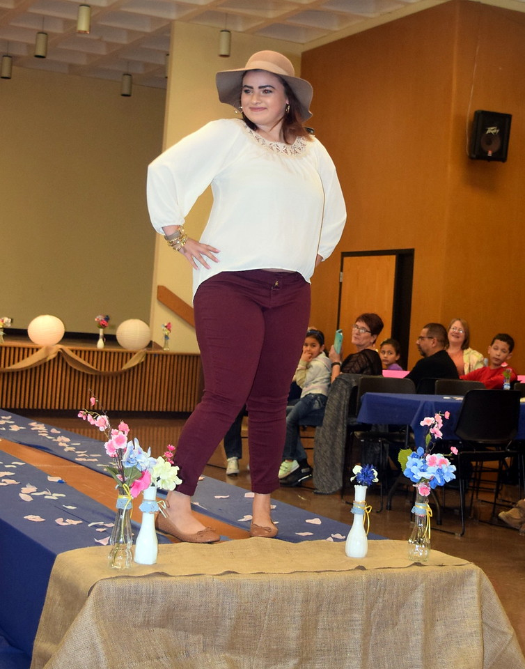 A Northeastern Junior College student models pants, a top and a hat from Bealls at the NJC Cosmetology Fashion Show Fundraiser Saturday, Feb. 25,  2017.