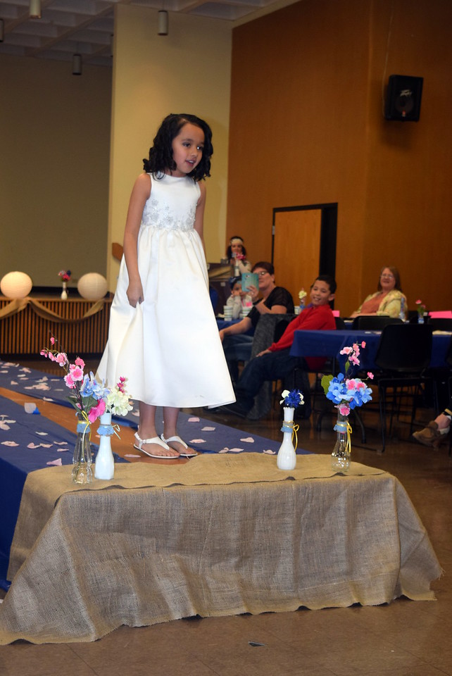 A youngster models a dress from Enchanted Dreams at the NJC Cosmetology Fashion Show Fundraiser Saturday, Feb. 25,  2017.