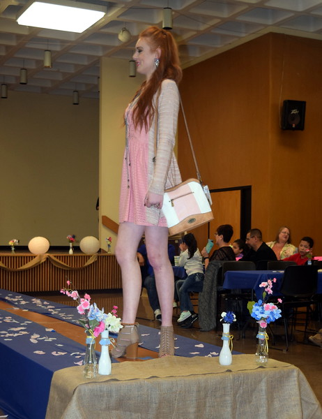 A Northeastern Junior College student models a dress and purse from Bealls at the NJC Cosmetology Fashion Show Fundraiser Saturday, Feb. 25,  2017.